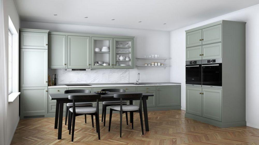 kuchnia z ciemno zielonymi meblami i szarymi ścianami