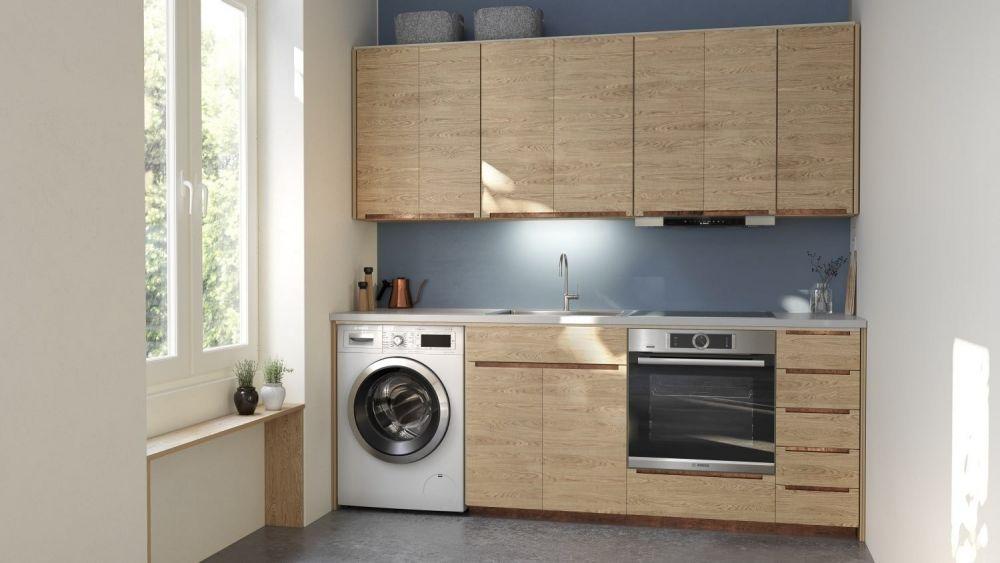 drewniana kuchnia z pralką i piekarnikiem w zabudowie